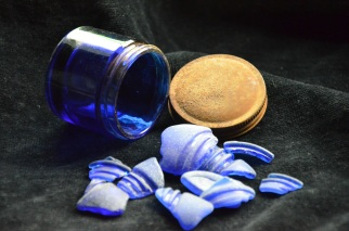 Blue glass usually originates from old Vicks jars and perfume bottles.