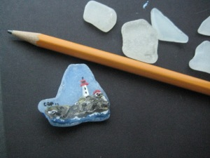 Glass painted with a lighthouse scene and glazed, then made in to a pin